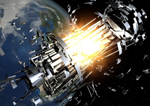 Взгляд художника на разрушение спутника и образование множества обломков (space.com)