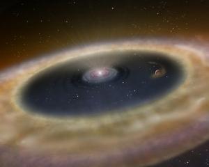 Взгляд художника на планету, недавно образовавшуюся в газопылевом облаке (space.com)