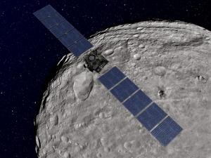 Рисунок зонда на орбите Весты (space.com)