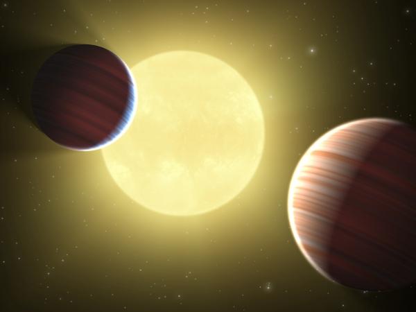 Рисунок двух газовых гигантов около звезды ()