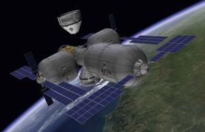 Рисунок будущей станции, к которой приближается корабль компании Боинг (space.com)