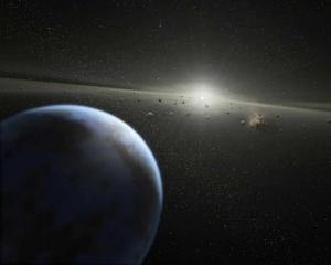 Рисунок планеты около белого карлика, окруженного астероидной пылью (space.com)