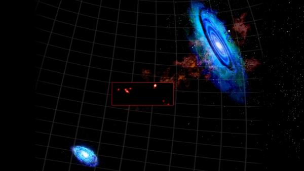 Наложение рисунка галактик М31 и М33 и снимка облаков (phys.org)