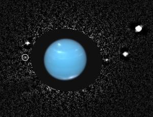 Наложение снимков Нептуна и его спутников (newscientist.com)