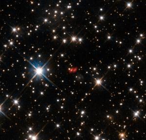 Далекая галактика PKS 1830-211 (eso.org)