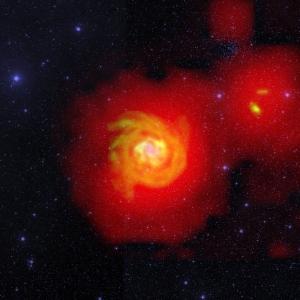Гало галактики NGC 6946 и ее компаньона, соединяемые рассеянным потоком водорода (nrao.edu)