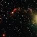 Две звезды сформировали странные очертания туманности.